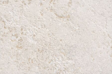 Beige limestone similar to marble natural surface for bathroom or kitchen countertop. High resolution texture and pattern. Stock Photo