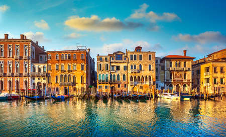 Venice, Grand Canal, gondolas and buildings at sunrise. Italy, Europe.