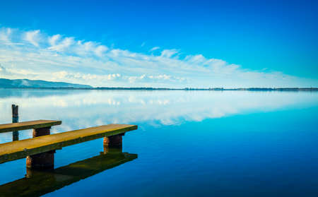 Two piers or jetties, sunset blue panoramic landscape. Orbetello lagoon in Maremma, Argentario, Tuscany, Italy. 스톡 콘텐츠