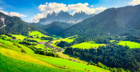 Funes Valley aerial view and Odle mountains, Dolomites Alps. Trentino Alto Adige Sud Tyrol, Italy, Europe