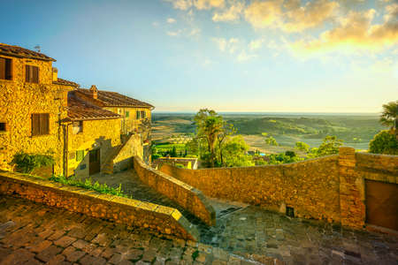 Casale Marittimo old village in and panoramic view at sunset. Sea on the horizon. Tuscany, Italy Europe.
