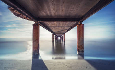 Pier seen from below, beach and sea in Marina di Pietrasanta. Long Exposure. Versilia Lucca Tuscany Italy 스톡 콘텐츠