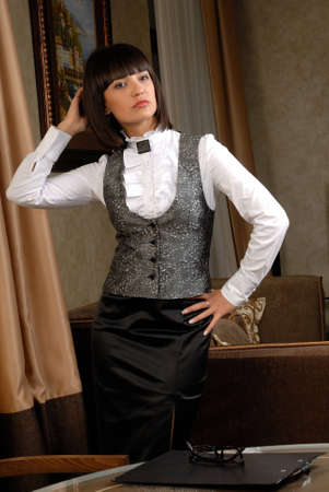 interiour: Businesswoman pictured in the neat interiour. Stock Photo