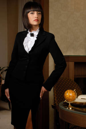 interiour: Businesswoman woman pictured in the neat interiour. Stock Photo