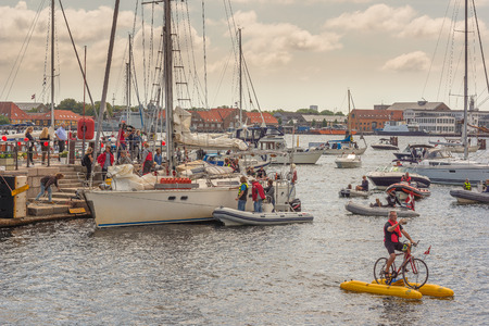popular: People greeting popular sailing boat after circumnavigation Editorial