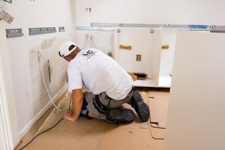 mounting: carpenter mounting IKEA kitchen Editorial