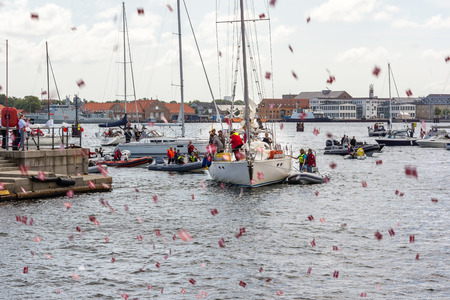 popular: Mini flags. People greeting popular sailing boat Editorial