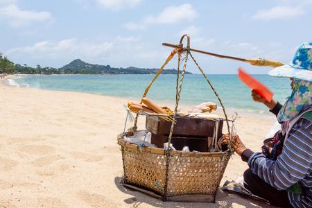 koh samui: April 07, 2016, Koh Samui, Thailand, Vendors basket on sandy beach Editorial