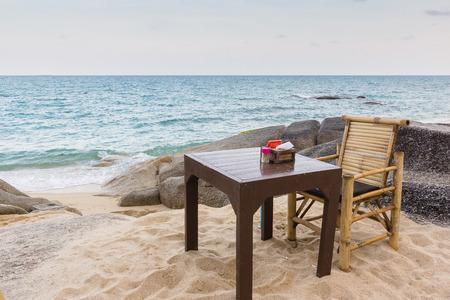 koh samui: April 07, 2016, Koh Samui, Thailand, A  table among the rocks, nex to the sea