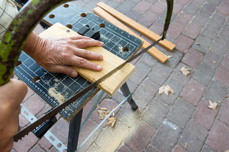 carpentery: Sept 22, 2016, Frederikssund, Denmark, Carpenter is sawing a plank Stock Photo