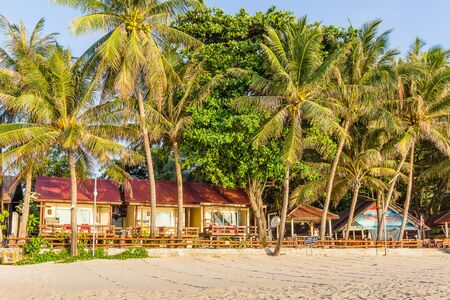 rin: Tropical beachfront bungalows with palms, Palita Lodge, Haad Rin, Koh Pangan, Thailand, May 06, 2016,