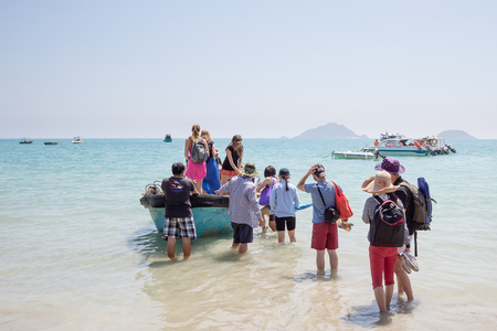 Young people embark for a snorkling tour, Con Dao, Vietnam, Feb 07, 2014, Editorial
