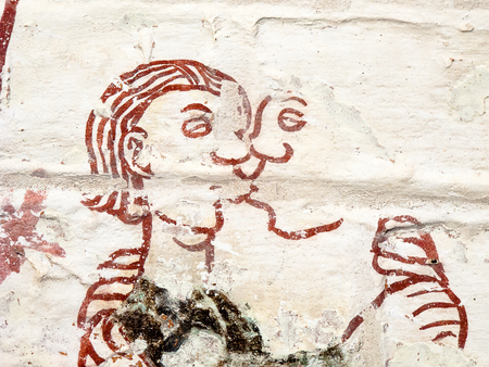 sins: Man and woman tender kissing. Medieval fresco in a Swedish church. One of  the seven deadly sins: Lust. (Luxoria) Sept 03, 2010,