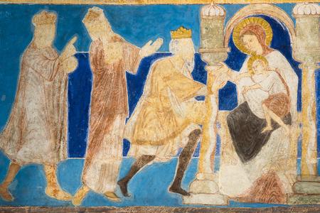 Romanesque fresco. The holy kings bring their gifts to the Christ child. Bjaresjo churh, Sweden, Sept 04, 2014,