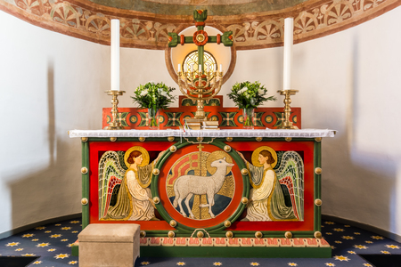 Altar with two angels and the Lamb of God On the altar is a seven-branched candlestick, Tveje Merlose, Denmark - January 23, 2017,