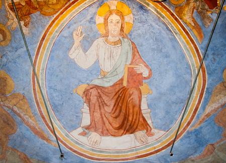 Majestas domini. Medieval mural of Christ , sitting on a throne. Slaglille, Denmark - September 24, 2010