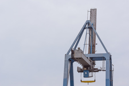 Container crane against blue sky at the port of Hundested, Denmark, July 10, 2017 Stock Photo