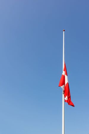 Danish flag at half-mast means death in the family or in the nation, Denmark,  August 23, 2017
