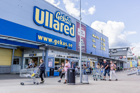 Walking to the entrance of GeKas, the biggest department store in Scandinavia, Ullared, Sweden, September 3, 2017