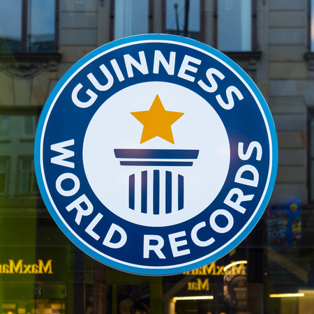 Guinness world records sign, reflections in a window, Copenhagen, Denmark, September 21, 2107 Editorial