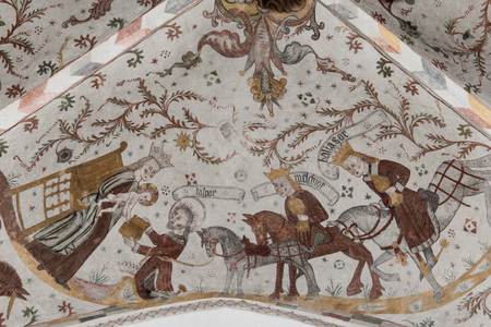 Three wise men on horses bring gifts to Mary and the Christ child, Fresco in Tingsted church, Denmark - April 11, 2017 Editorial