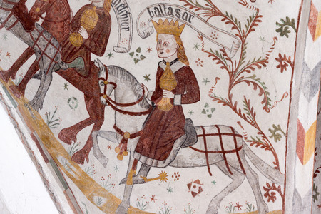 Gothic fresco of Balthasar, one of the three holy kings, riding a white horse, Tingsted church, Denmark - April 11, 2017