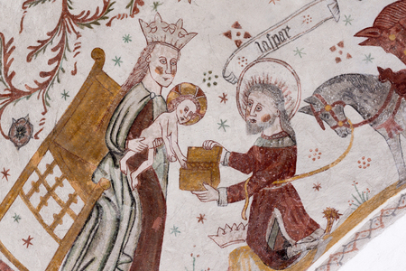 Medieval fresco of Caspar, one of the three wise men. He brings gifts to Mary and the Christ child, Fresco in Tingsted church, Denmark - April 11, 2017 Editorial