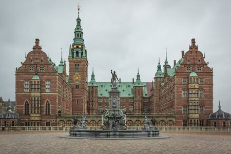 Fountain i front of Frederiksborg castle  at Hillerod, Denmark, February 6, 2018 Editorial