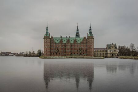 Wintertime and reflections in the ice of the lake at Frederiksborg Castle, Hillerod, Denmark, February 6, 2018