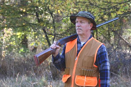 marksman: Man carrying a shotgun