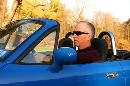 Middle-aged Man in a Blue Convertible