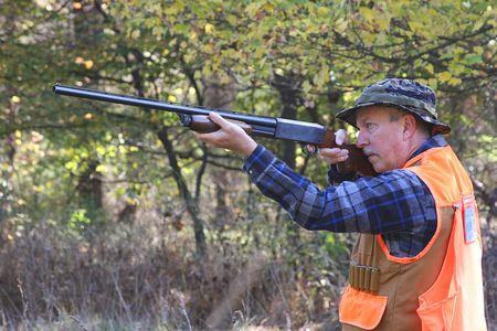 rifleman: Hunter shooting a shotgun
