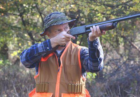 rifleman: Man shooting a shotgun while hunting