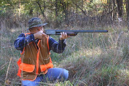 Hunter shooting a gun Stock Photo