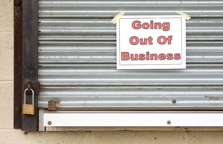 that: Closed locked steel door of a business that has gone bankrupt