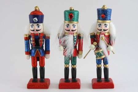 Three wooden toy soldier Nutcrackers