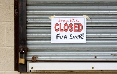 insolvent: Storefront of a business that has gone bankrupt and locked its doors