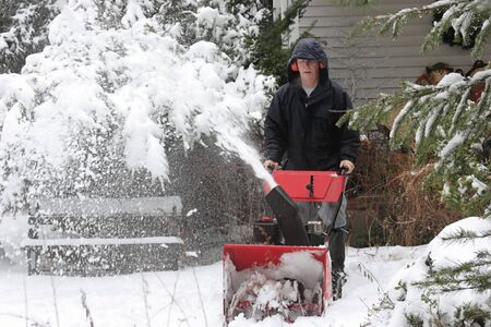snow clearing: Man Using A Snow Blower