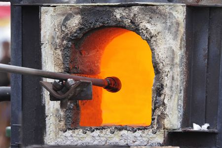 Glass being melted in a kiln to begin the process of glass blowing
