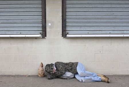 itinerant: Homeless man asleep on the sidewalk
