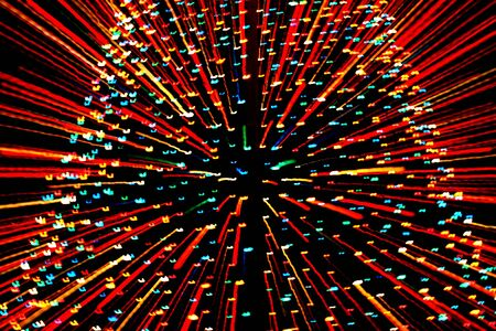 light zoom: Zooming in on a large Christmas Tree covered with lights