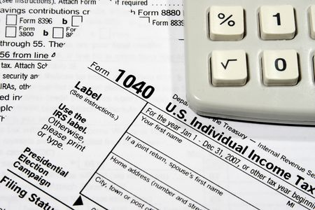 Close-up of a Federal Tax Return Form and a calculator Stock Photo