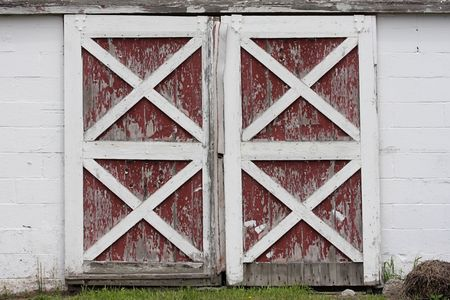 Rustic old red and white barn doors with peeling paint Stock Photo - 4874630