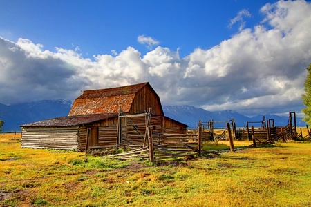 Iconic Mormon Row Barn which is a structure that is a part of Grand Tetons National Parks with the Teton Mountain Range in the background Stock Photo