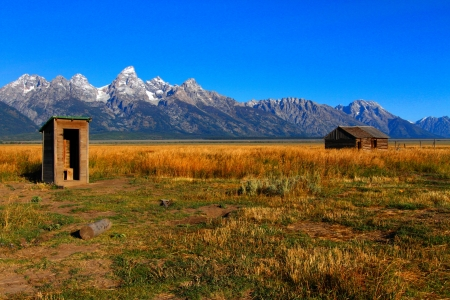 wyoming: Iconic Mormon Row Barn which is a structure that is a part of Grand Tetons National Parks with the Teton Mountain Range in the background Stock Photo