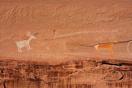 anasazi: Ancient Anasazi and Navajo Pictographs in Canyon de Chelly National Park in Arizona Stock Photo