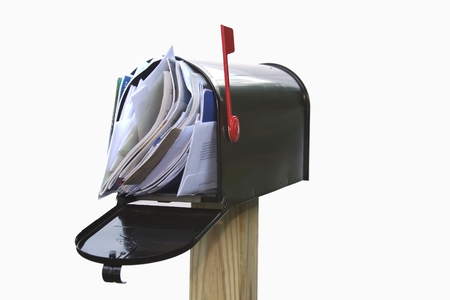 junk: Mail box overflowing with mail, bills, junk mail, e-mails and other unwanted correspondence
