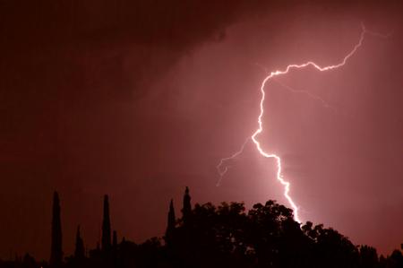 desert storm: Lightning striking the ground during a storm in the Arizona desert Stock Photo