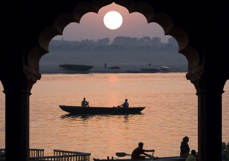 Sunrise over the Holy River Ganges in Varanasi in the Uttar Pradesh region of northern India