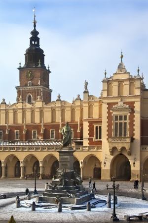 mickiewicz: The Cloth Hall - Sukiennice - and Town Hall Tower in the main market square (Rynek Glowny) in Cracow in Poland. The statue is of Adam Mickiewicz.  The Cloth Hall dates from 1895.
